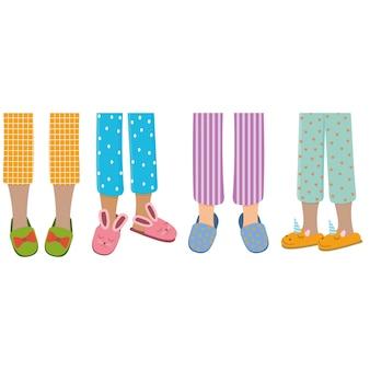 Pernas de meninas de pijama e chinelos
