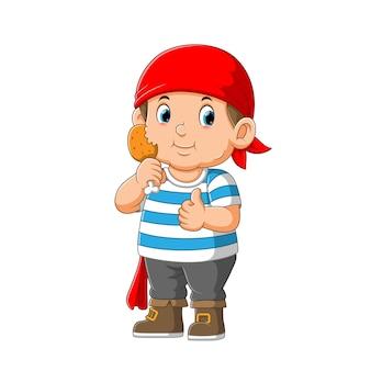 Personagem de desenho animado de criança pirata segurando ilustração de frango frito