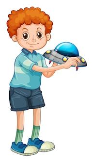 Personagem de desenho animado de menino estudante segurando um modelo de ovni