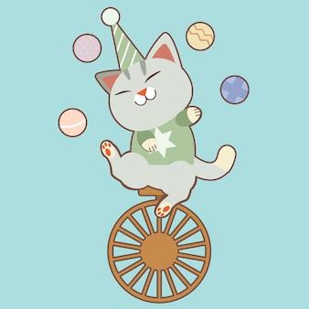 Personagem de gato bonito jogando bolas e sentado em uma roda de bicicleta.