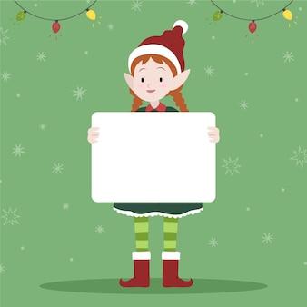 Personagem de natal segurando uma faixa em branco
