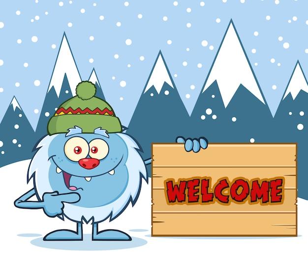 Personagem de yeti com chapéu apontando para um sinal de boas-vindas