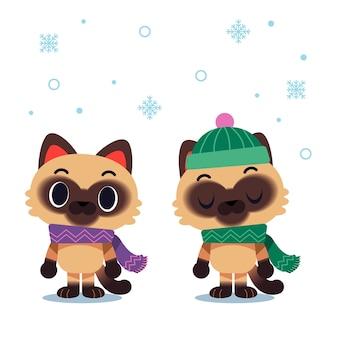 Personagens de gato com cachecol e chapéu de inverno