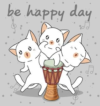 Personagens de gato kawaii com um tambor