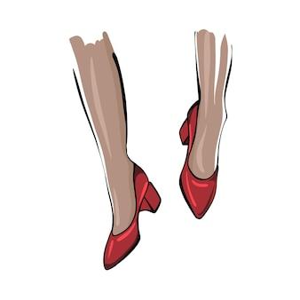 Pés femininos em sapatos vermelhos