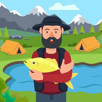 Pescador com peixe na mão no acampamento.