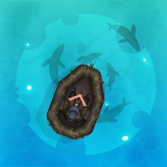 Pescador em um barco de borracha. peixe na vista superior da água. oceano, rio ou lago com água azul clara.