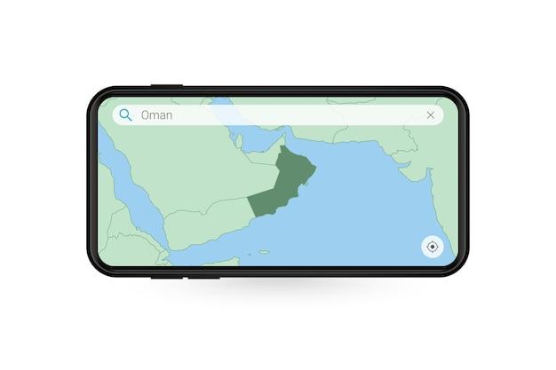 Pesquisando o mapa de omã no aplicativo de mapa do smartphone. mapa de omã no telefone celular.