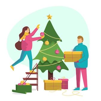 Pessoas adoráveis decorando a árvore de natal