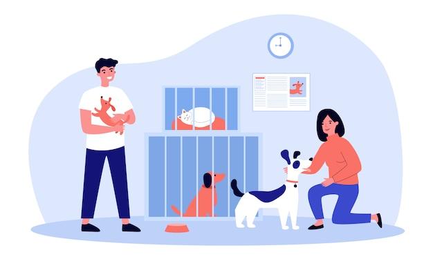 Pessoas adotando animais de estimação de um abrigo
