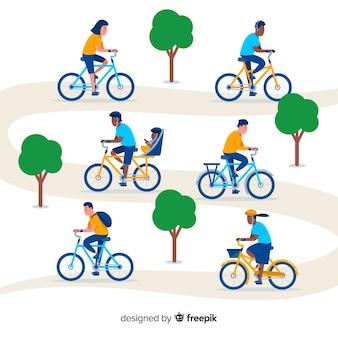 Pessoas andando de bicicleta na coleção parque