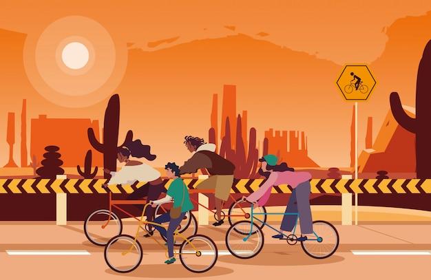 Pessoas andando de bicicleta na paisagem do deserto com sinalização para ciclista