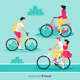 Pessoas andando de bicicleta no parque conjunto