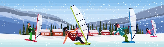 Pessoas andando de snowboard na neve