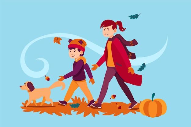 Pessoas andando no outono com cachorro