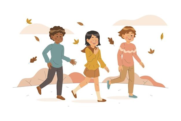Pessoas caminhando no conceito de outono