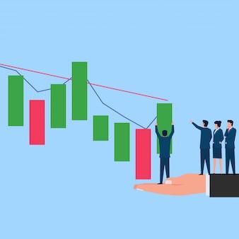 Pessoas colocam gráfico de negociação de ações na posição de compra ajudando com a mão.