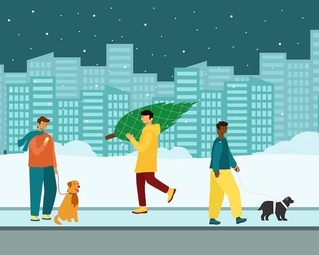Pessoas com animais de estimação andam do lado de fora no inverno.
