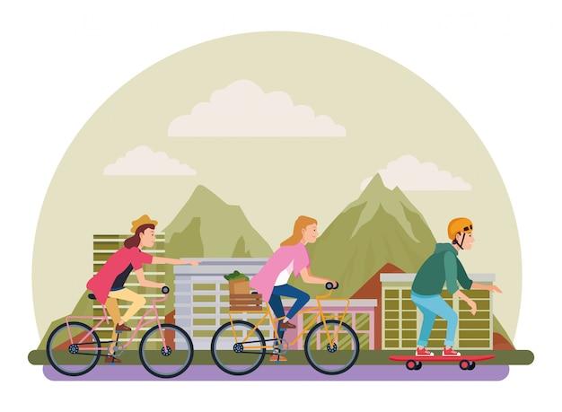 Pessoas com bicicletas e skate