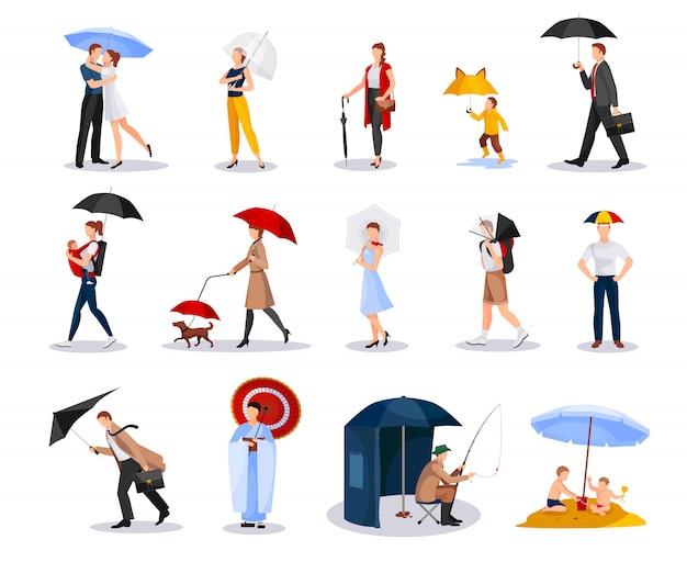 Pessoas com coleção de guarda-chuvas