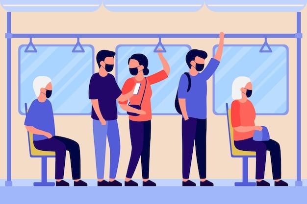 Pessoas com máscara protetora ficam de pé e sentam no transporte do metrô