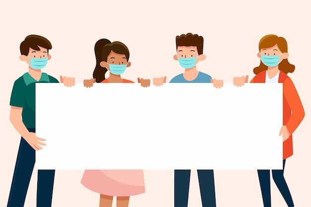 Pessoas com máscaras médicas com cartazes