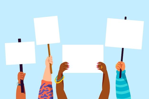 Pessoas com os braços levantados com cartazes vazios