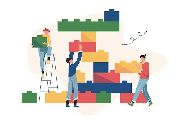 Pessoas conectando os elementos dos blocos