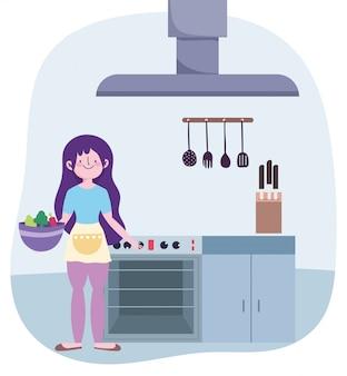Pessoas cozinhando, menina com legumes tigela fogão móveis cozinha