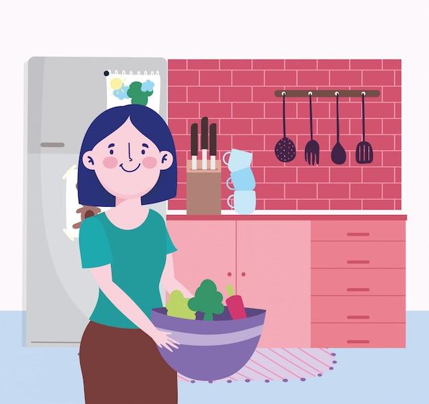 Pessoas cozinhando, mulher com tigela de legumes facas talheres na cozinha