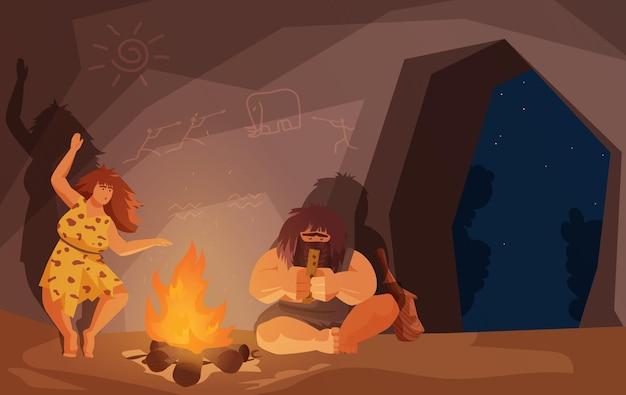 Pessoas da família primitiva da idade da pedra sentam-se perto do fogo, homem das cavernas tocando música, mulher dançando Vetor Premium