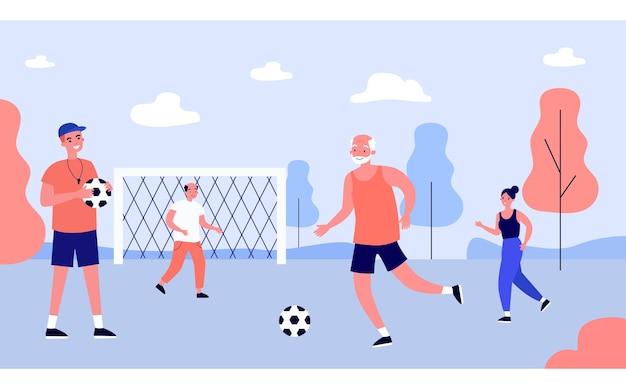 Pessoas de diferentes idades jogando futebol com o treinador