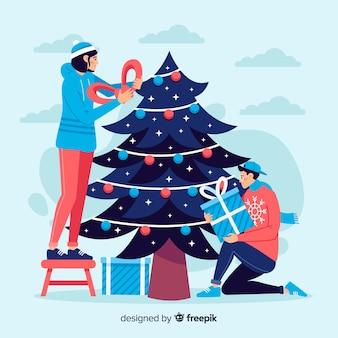 Pessoas decorando a árvore de natal com enfeites pack