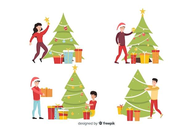 Pessoas decorando a árvore de natal e usando chapéu de papai noel