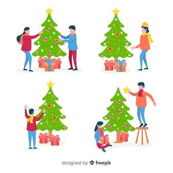 Pessoas decorando árvores de natal