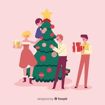 Pessoas decorando conjunto de árvore de natal