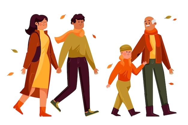 Pessoas diferentes caminhando no outono