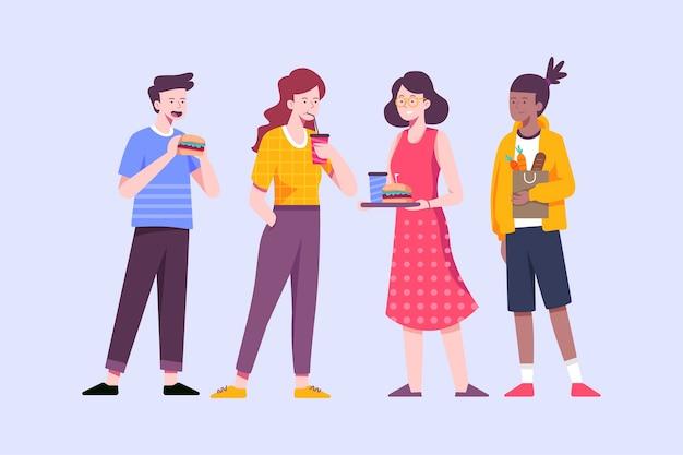 Pessoas em pé e comendo fast-food