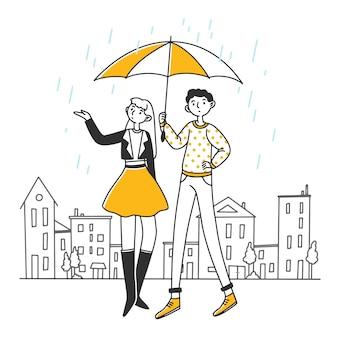 Pessoas em pé sob o guarda-chuva em dia chuvoso