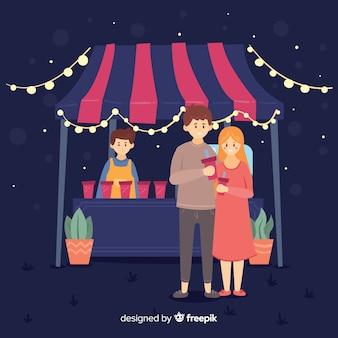 Pessoas em uma feira de noite