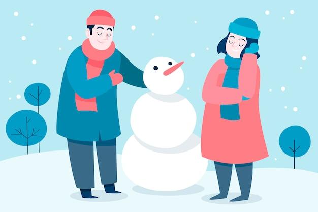 Pessoas fazendo um boneco de neve no inverno