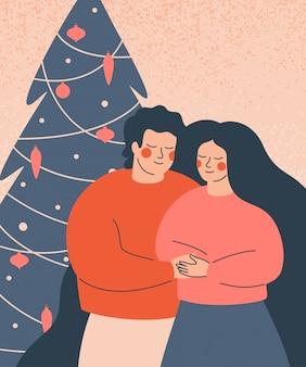 Pessoas felizes comemoram as férias de inverno. uma jovem família fica na árvore de natal decorada.