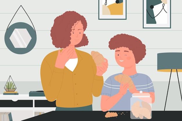 Pessoas felizes da família comem croissants saboreando lanches doces no interior da casa da cozinha