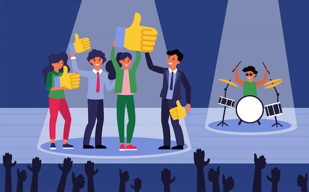 Pessoas felizes no palco mostrando gostos