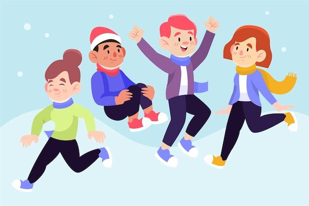 Pessoas felizes vestindo roupas de inverno pulando