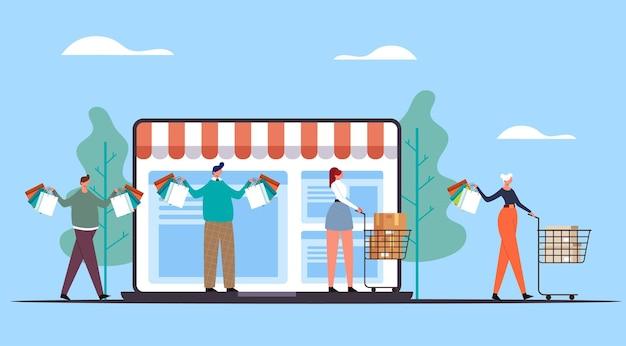 Pessoas homem mulher personagens fazendo compras e carregando sacolas. conceito de compra da web de internet online.
