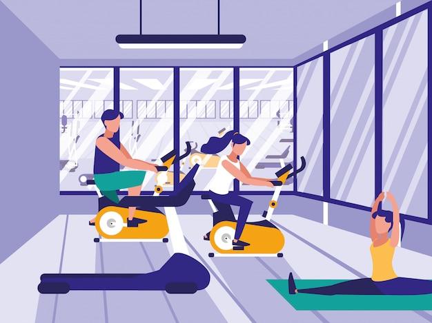 Pessoas na academia praticando esportes