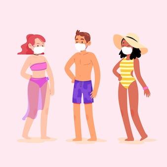 Pessoas na praia vestindo máscaras