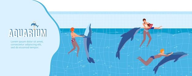 Pessoas nadam com ilustração de golfinhos.