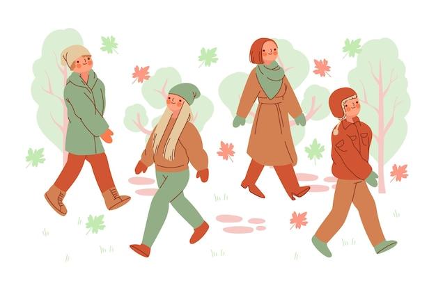 Pessoas no pacote de parque de outono